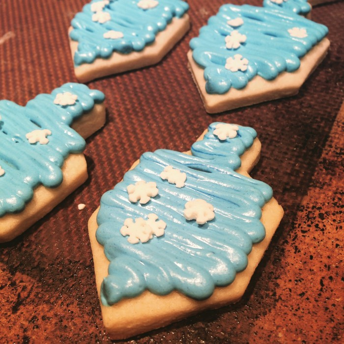 Dreidel sugar cookies with blue royal icing and white snowflakes